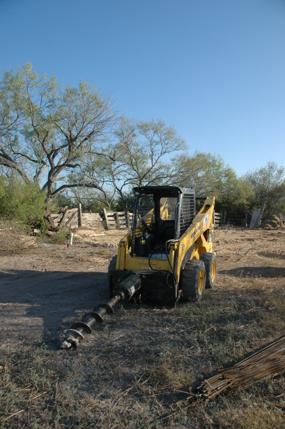 bobcat w/ post hole drill